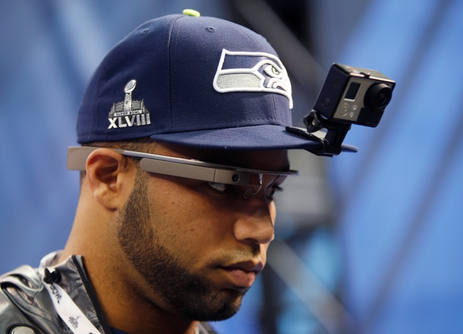 Seattle Seahawks wide receiver Golden Tate wears Google Glasses and a GoPro camera on his hat as he is interviewed during Media Day for Super Bowl XLVIII at the Prudential Center in Newark, New Jersey January 28, 2014.