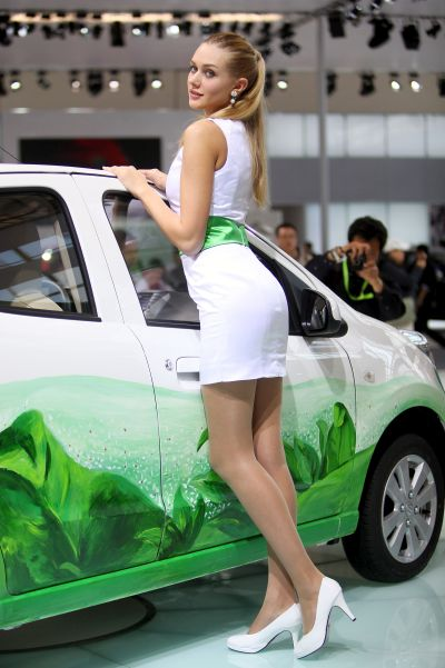 A model stands beside China's Changan car during a special media opening of the Beijing Auto Show.