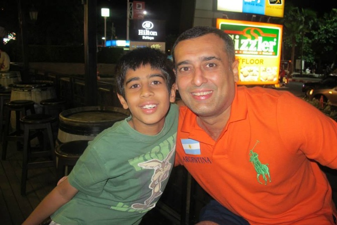 Amit Burman with his son.