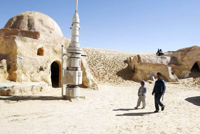 Local boys sell traditional souvenirs in the Star Wars movie set in the Ong Jmal, in Nefta, southern Tunisia.