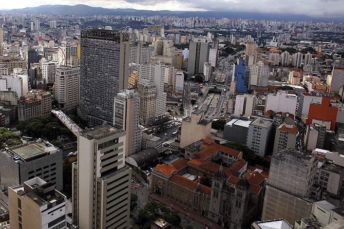 A general view shows the Sao Bento Monastery (R) between skyscrapers at downtown Sao Paulo.