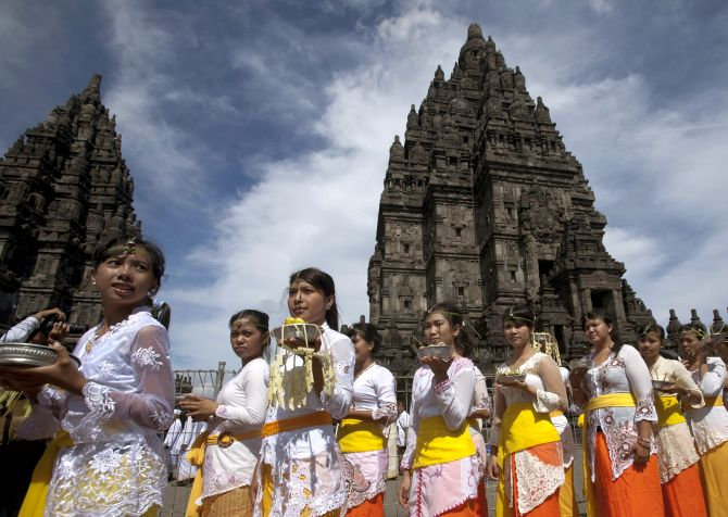 Balinese Hindu worshipers walk during the Tawur Agung ritual ahead of Nyepi, Bali's Day of Silence and the Hindu New Year, at Prambanan temple in Yogyakarta.