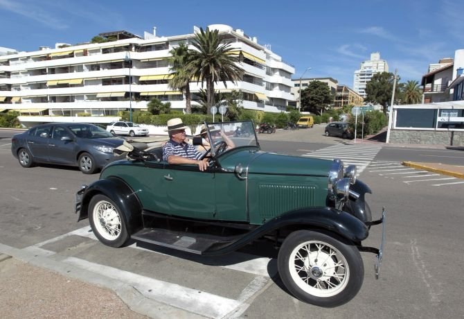 A man drives his 1935 Ford A through the streets of the luxurious seaside resort of Punta del Este.