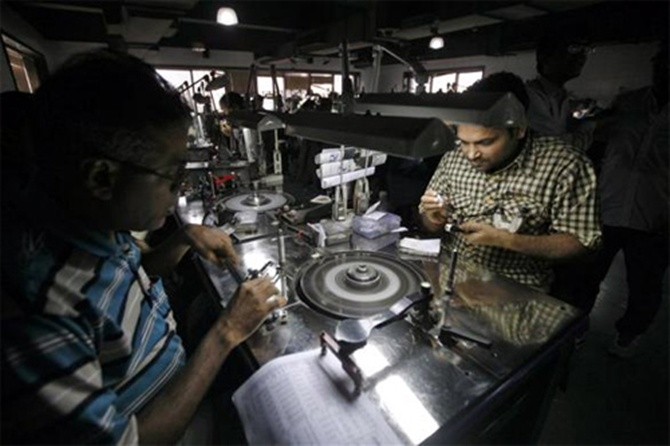 Employees work inside the polishing department of a diamond processing unit at Surat.
