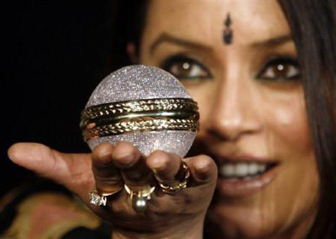 Actress Mahima Chaudhary holding a diamond studded ball.