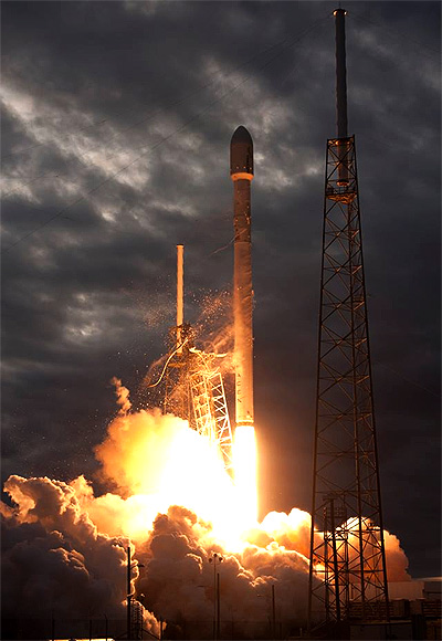 SpaceX rocket taking off to deliver cargo to International Space Station.