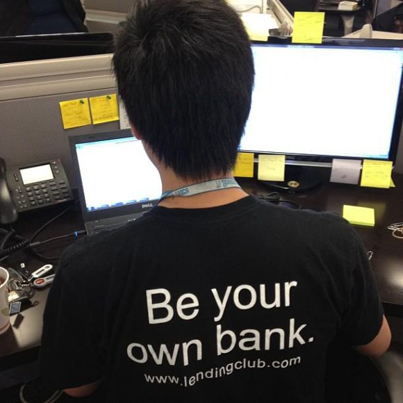 Treasury Analyst sporting a classic Lending Club t-shirt.