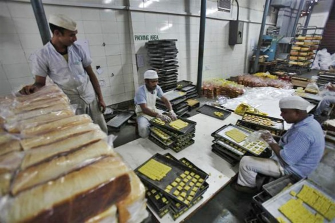 Inmates prepare cookies at a bakery inside the Tihar Jail complex in New Delhi.