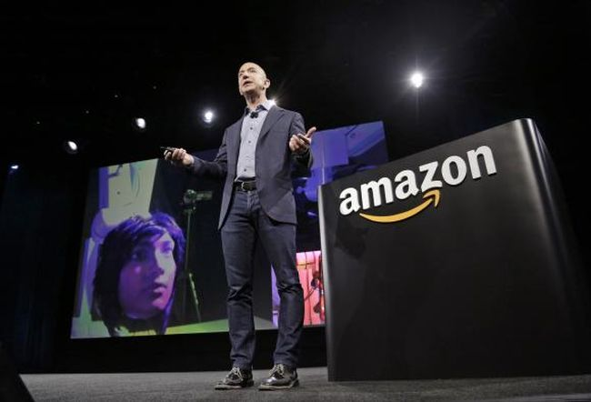 Amazon CEO Jeff Bezos discusses his company's new Fire smartphone at a news conference in Seattle, Washington in this file photo taken June 18, 2014.