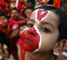 Image: Boys with their faces painted before a play reenacting a scene from the Ramayana. Photograph: Ajay Verma/Reuters