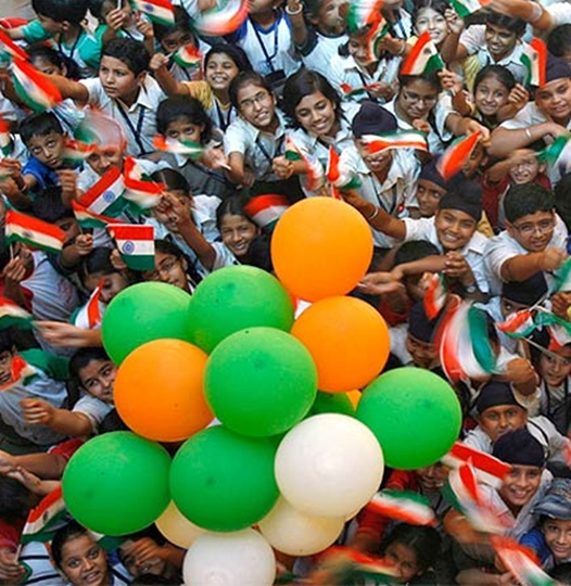 Students wave national flags in Chandigarh.