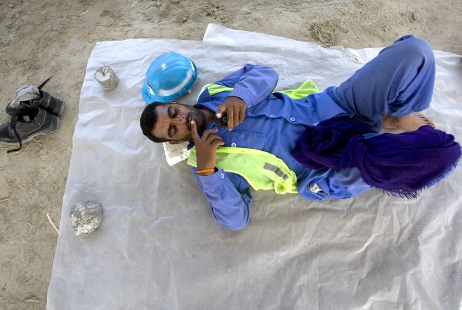 A labourer takes a break at a construction site near the Dubai Mall.
