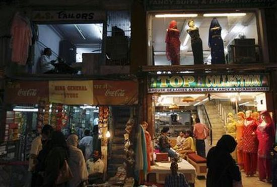 Women shop at a market place in the old quarters of Delhi.