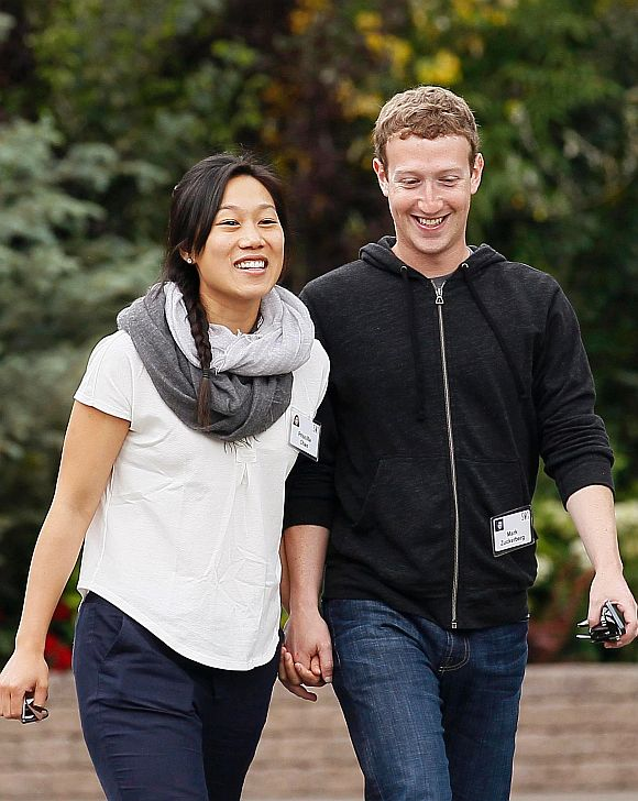 Facebook CEO Mark Zuckerberg walks with his wife Priscilla Chan at the annual Allen and Co. conference at the Sun Valley, Idaho Resort