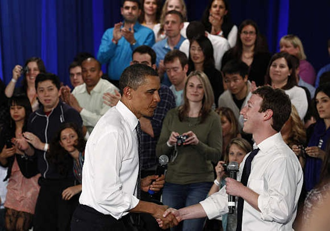 US President Barack Obama with Mark Zuckerberg in Palo Alto, California.