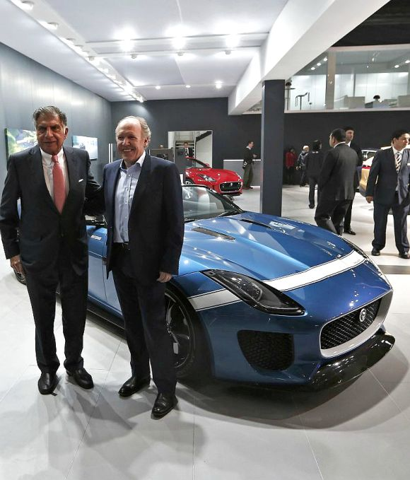 Indian businessman Ratan Tata, former chairman of the Tata Group, and Ian Callum (R), design director at Jaguar, stand next to the Jaguar Project 7 concept car.