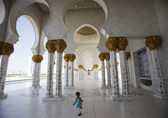 A child plays inside Sheikh Zayed mosque in Abu Dhabi.