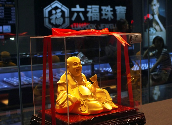 A gold Buddha statuette is seen inside a Luk Fook Jewellery shop in Yichang, Hubei province.