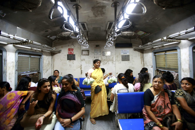 A vendor sells vegetables inside the Ladies' Special train in Mumbai