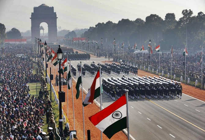 People watch Indian soldiers march during the Republic Day parade in New Delhi.