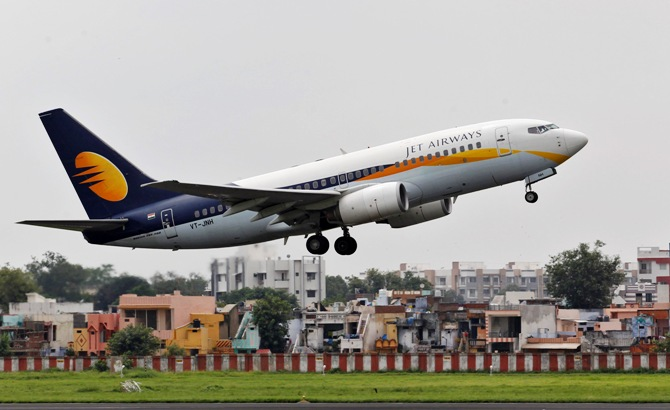 A Jet Airways passenger aircraft takes off from the airport in Ahmedabad.