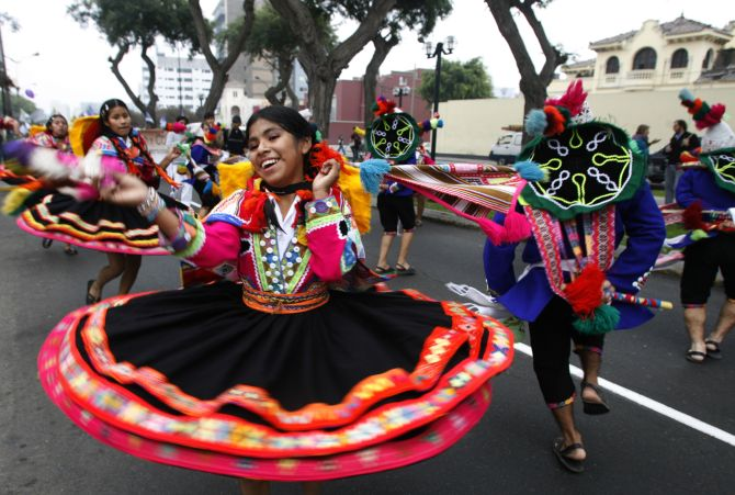 A girl dances during a protest in Lima to demand that the G8 countries comply with their commitment to increase aid to the poorest nations.