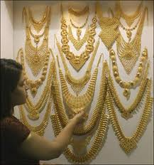 An employee makes gold studs at a jewellery workshop.