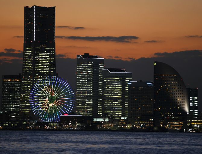 The sun sets over the venue of the APEC Summit in Yokohama, south of Tokyo.