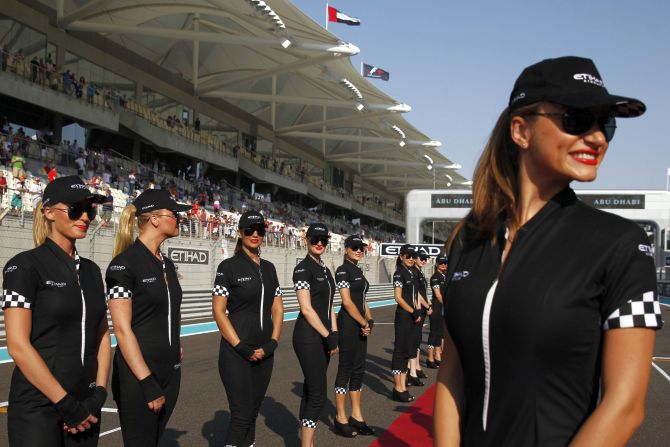 Grid girls pose before the Abu Dhabi F1 Grand Prix at the Yas Marina circuit on Yas Island.