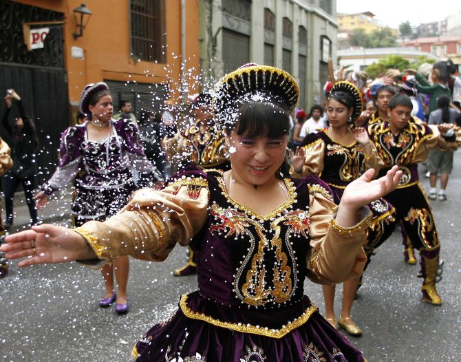 A reveller takes part in the Cultural Carnival in Valparaiso city, about 75 miles (120 km) northwest of Santiago.