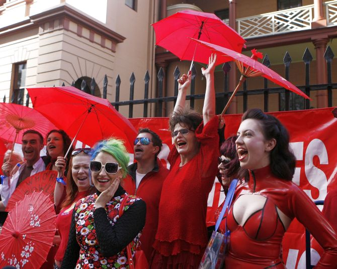 Sex workers shout slogans during International Whores Day in central Sydney.