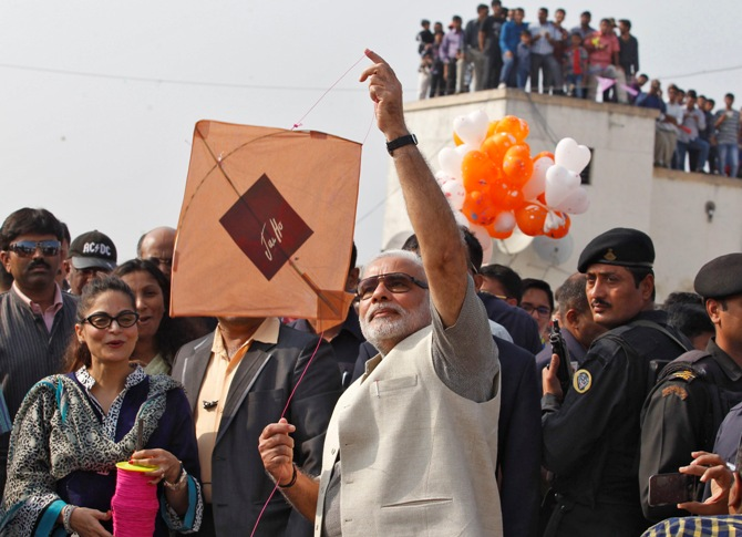 Narendra Modi flies a kite during a kite flying festival in Ahmedabad.