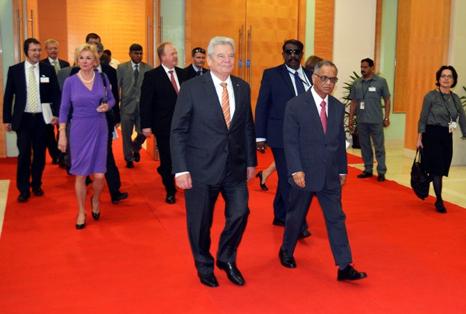German President Joachim Gauck (C) arrives with Infosys Executive Chairman and co-founder NR Narayana Murthy to address an Indo-German conference at Infosys headquarters in Bengaluru.