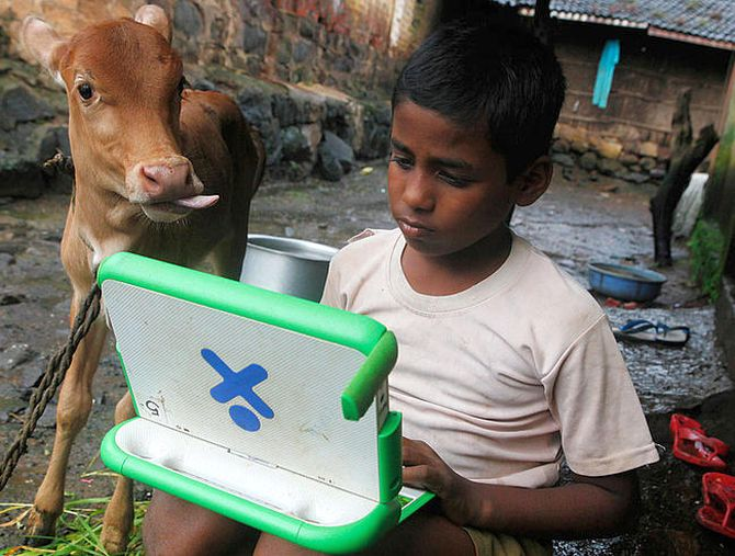 Harish, 11, a school boy uses a laptop provided under the One Laptop Per Child' project by a non-governmental organisation (NGO).
