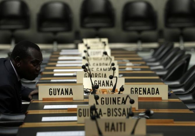 A delegate waits for the opening of a session of the Trade Negotiation Committee at the World Trade Organization (WTO) in Geneva.