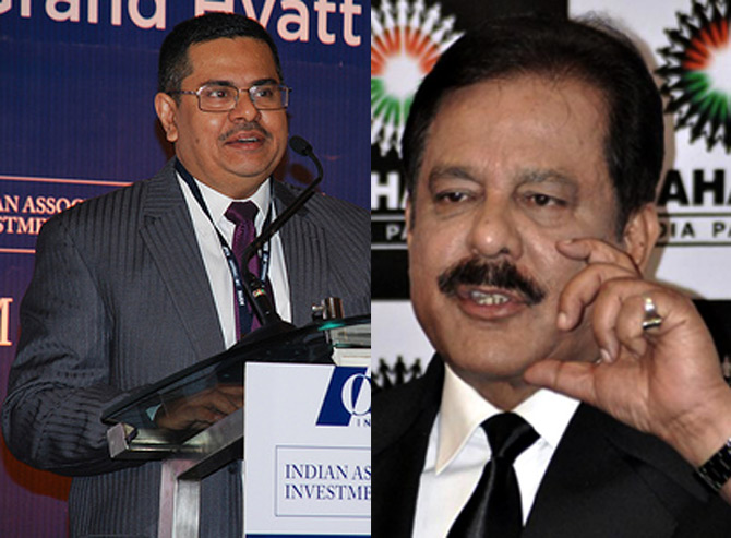 K M Abraham (L) and Subrata Roy (R).