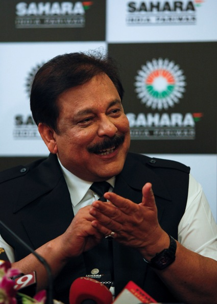 Sahara Group Chairman Subrata Roy gestures as he speaks during a news conference in Mumbai.