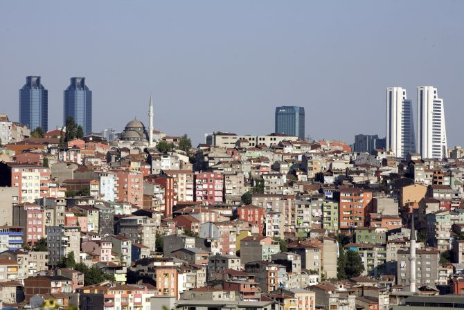 Skyscrapers in the city's business district shape the skyline over Gultepe district in Istanbul.