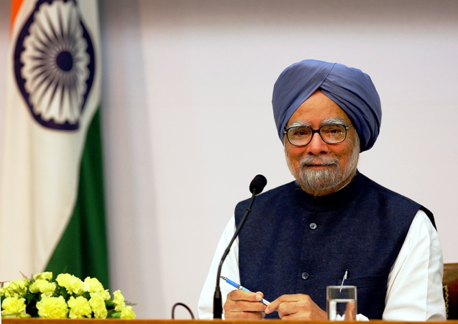 Prime Minister Manmohan Singh smiles during a press conference in New Delhi.