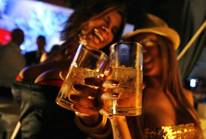 Venezuelan women dance and drink whisky during a Playboy magazine party in Caracas.