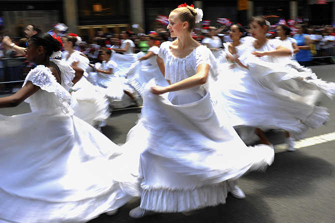 Dancers participate in the Puerto Rican Day Parade along New York's Fifth Avenue.