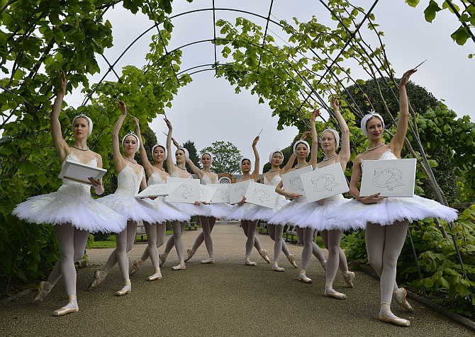 Members of the English National Ballet pose with canvases outside The Orangery at Kensington Palace in London.