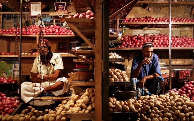 Vendors waits for customers at their stalls at a wholesale food market in Mumbai December 16, 2013.