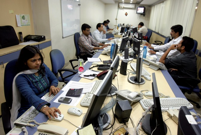 This file photograph shows brokers trading on their computer terminals at a stock brokerage firm in Mumbai.