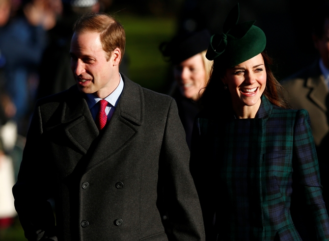 Britain's Prince William and Catherine, the Duchess of Cambridge, walk to a Christmas Day morning service at the church on the Sandringham Estate in Norfolk.