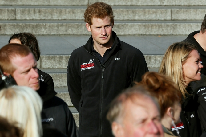 Britain's Prince Harry attends the Walking with the Wounded South Pole Allied Challenge 2013 British team departure event at Trafalgar Square in London November 14, 2013.