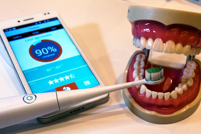 A Kolibree connected electric toothbrush is displayed during the 2014 International Consumer Electronics Show (CES) in Las Vegas, Nevada, January 8, 2014.
