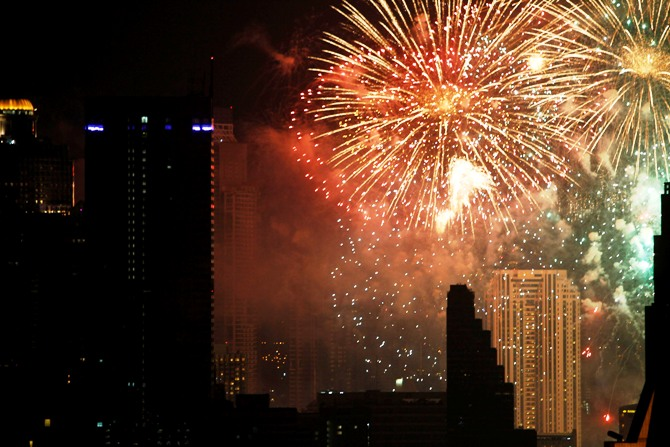 Fireworks explode during New Year celebrations over the city centre of Thailand's capital Bangkok.