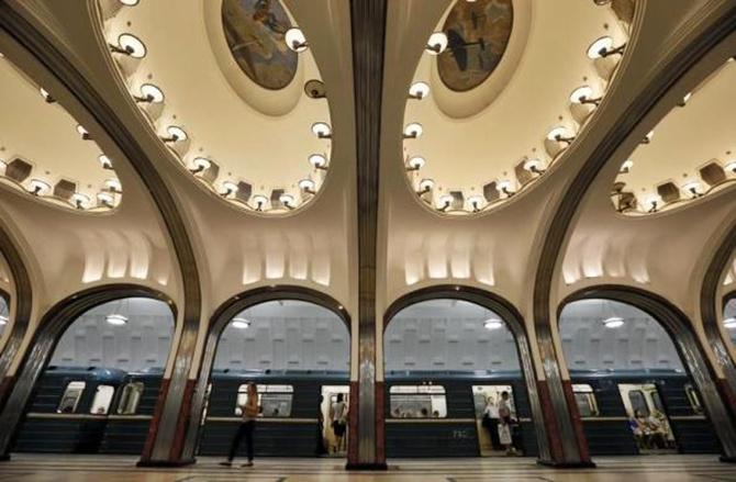 A woman walks on the platform as a train arrives at Mayakovskaya metro station, which was built in 1938, in Moscow.