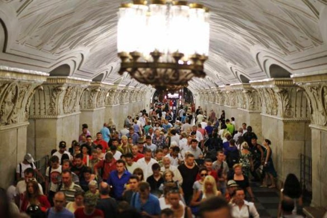 People walk through Prospekt Mira metro station in Moscow